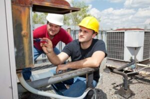 Technicians working on an AC Unit St. Louis
